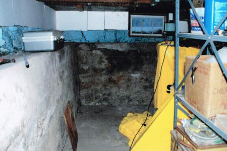 Moldy, dark basements can be made more inviting. (Before)